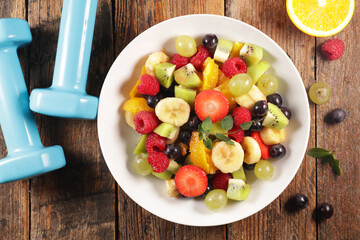 health food- fruit salad with dumbbell