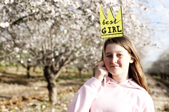 Outdoor close up portrait of teen 12 years old girl celebrating birthday