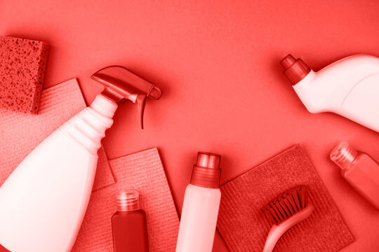 House cleaning products are on red background.