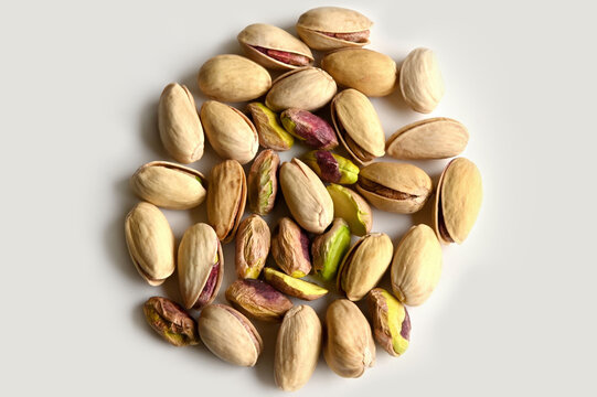 Pistachios in walnut shell on white background, composition of pistachios excellent for a healthy and dietetic diet,antioxidant food
