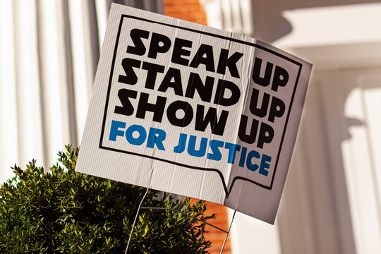 "An anonymous yard sign that says: ""Stand up, speak up, show up for justice"" referring to recent events  related to racism, discrimination and civil liberties, that lead to social unrest in USA."