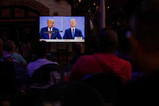 A television screen broadcasts the second 2020 presidential campaign debate between Democratic presidential nominee Joe Biden and U.S. President Donald Trump at The Abbey Bar during the outbreak of the coronavirus disease (COVID-19), in West Hollywood