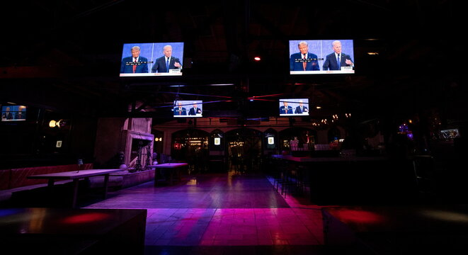 Television screens broadcast the second 2020 presidential campaign debate between Democratic presidential nominee Joe Biden and U.S. President Donald Trump at The Abbey Bar during the outbreak of the coronavirus disease (COVID-19), in West Hollywood