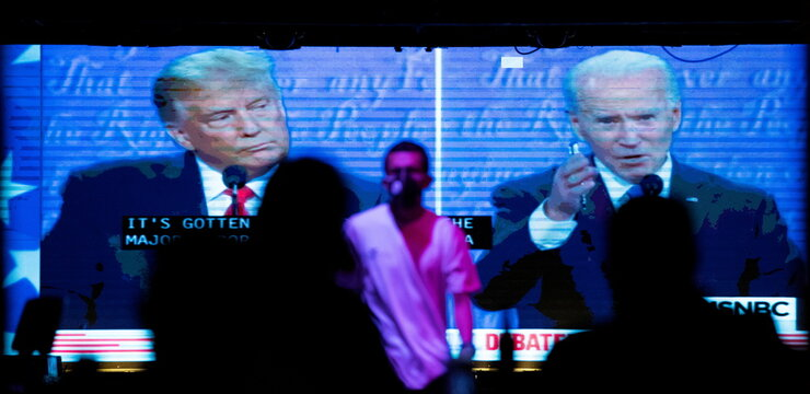People watch the second 2020 presidential campaign debate between Democratic presidential nominee Joe Biden and U.S. President Donald Trump at The Abbey Bar during the outbreak of the coronavirus disease (COVID-19), in West Hollywood