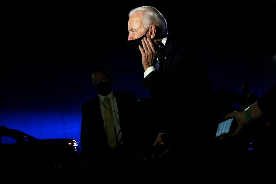 U.S. Democratic presidential candidate Joe Biden talks to reporters while leaving, following the final 2020 U.S. presidential campaign debate, at Nashville International Airport in Nashville