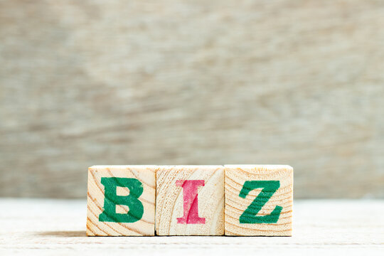 Alphabet letter in word biz (abbreviation of business) on wood background