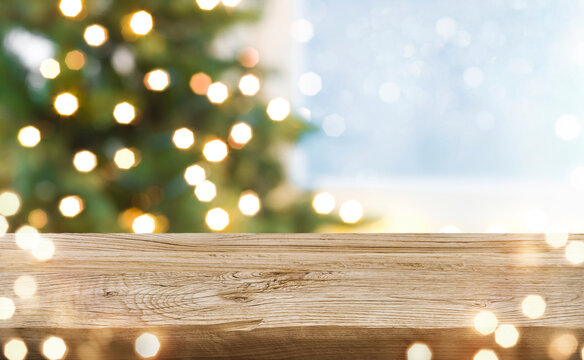 Unique texture wooden board and blurred winter holiday lights background