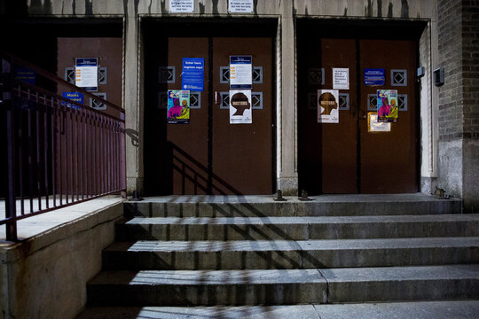 Posters are seen at Jules E. Mastbaum High School, an early voting location for the upcoming presidential election, in Philadelphia, Pennsylvania