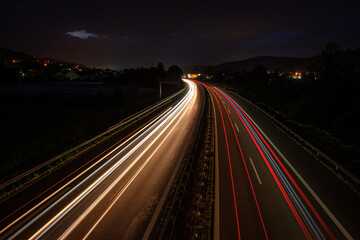Many light trails in night of cars and trucks Fotomurales