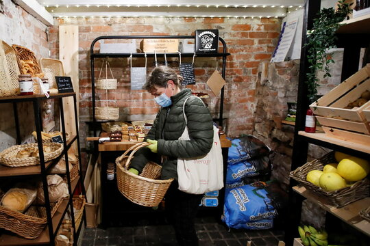 A customer shops at The Farm Fresh Market, a farm shop that has offered free lunches to children who need it over half term, as the spread of coronavirus diseases (COVID-19) continues, in Watnall, Nottingham
