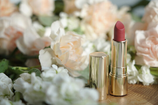 red lipstick on a background of flowers