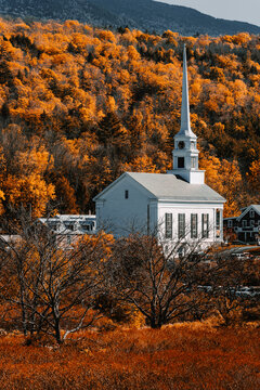 Small charming Community Church in ski town of Stowe in Vermont at fall
