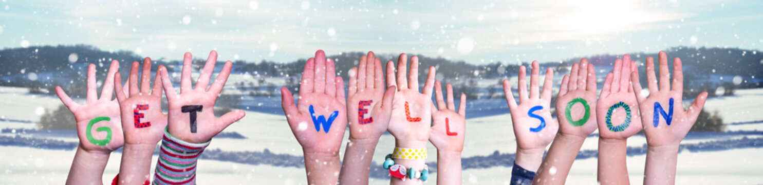 Children Hands Building Colorful English Word Get Well Soon. Snowy Winter Background With Snowflakes