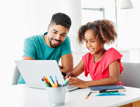 laptop computer education father children daughter girl familiy childhood home child parent homework