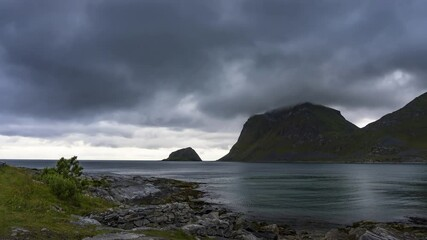 Wall Mural - Timelapse of clouds moving over Haukland beach on Lofoten islands in Norway
