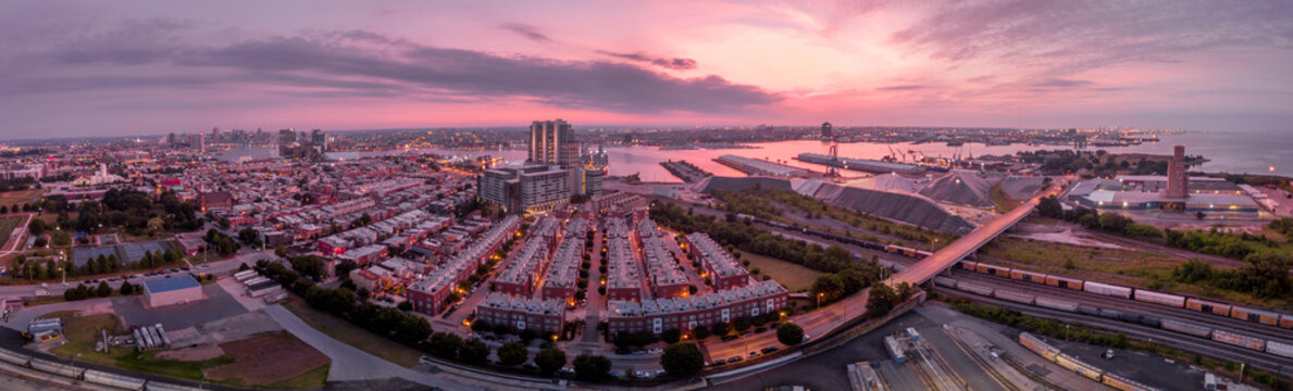 Aerial sunrise panorama of Locust point on the Chesapeake in Baltimore with colorful sky