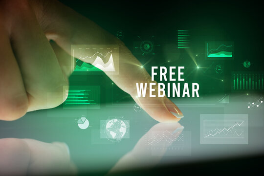 Finger touching tablet with charts and FREE WEBINAR inscription, business concept