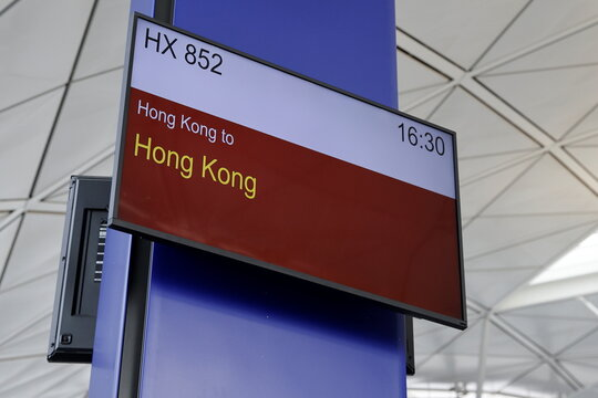 "A screen showing information is seen before boarding for Hong Kong Airline's Embrace ""Home"" Kong ""flight to nowhere"" experience, in Hong Kong"