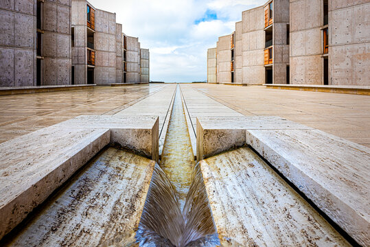 La Jolla, USA - December 10, 2015: Symmetrical architecture building of the Salk Institute in San Diego with fountain vanishing point diminishing perspective