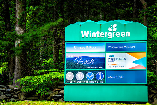 Wintergreen, USA - June 9, 2020: Green summer at ski resort town village in Blue Ridge mountains in summer with sign at entrance for music festival and activities