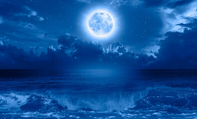 Wall Mural - Night sky with blue moon in the clouds