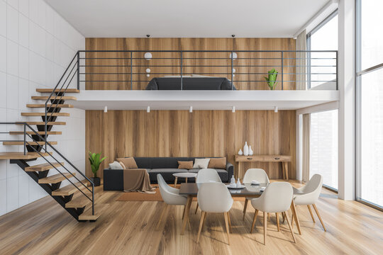Wooden living room with white chairs and table, wooden stairs to the bedroom
