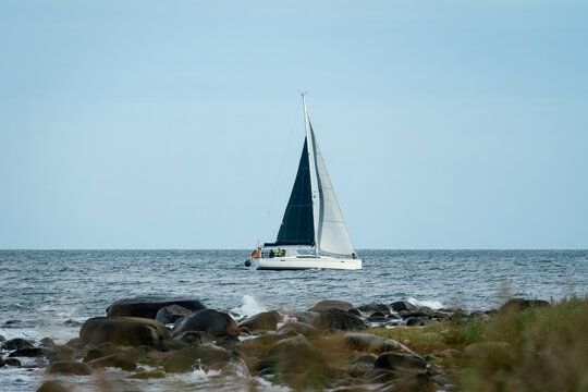 Sailing boat on the waves of the baltic sea