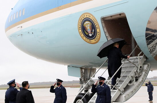 U.S. President Donald Trump boards Air Force One for campaign travel to New Hampshire