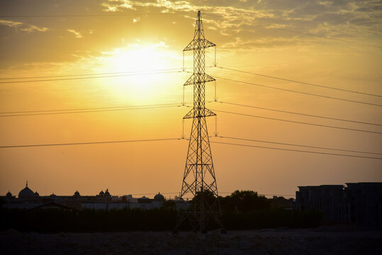 High voltage power line at sunset in an arab country