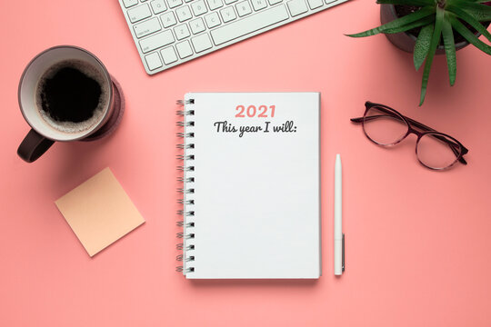 Stock photo of 2021 new year notebook ready to write goals in it, on a pink background