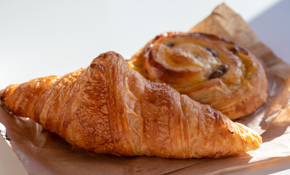 French breakfast in bakery served outdoor, fresh baked croissants and sweet pastry, morning food