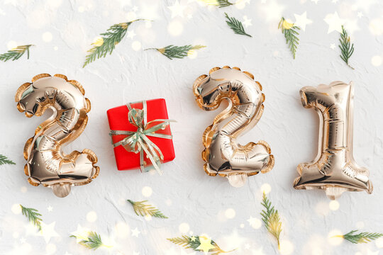 Beautiful New Year composition with figure 2021 on light background