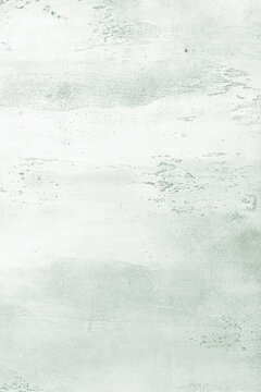 Light green textured concrete background with a darker base in the recesses. Abstract texture for graphic design or wallpaper