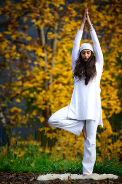 Young woman during a yoga practice in the autumn nature