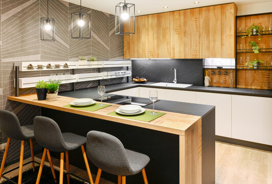 Modern fitted kitchen interior with bar counter