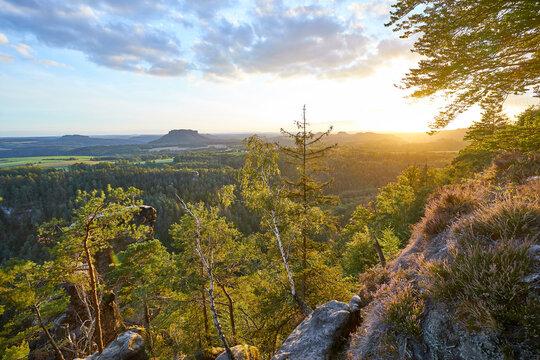 """Saxon Switzerland. View at sunset from area """"Brand"""" to landmark """"Lilienstein""""."""