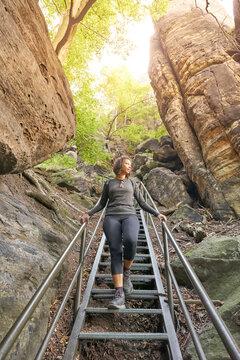 Black woman hiking in Elbsandstein Mountains in Saxon Switzerland, Germany