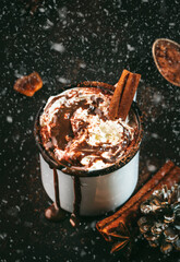 Hot chocolate with whipped cream and cocoa powder in metal mugs. Winter and autumn time. Christmas warm drink. Copy space