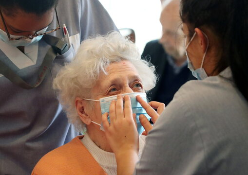 Employees at the house for elderly Residence Christalain take care of residents during the coronavirus disease (COVID-19) outbreak, in Brussels