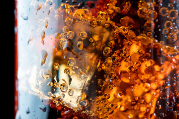 ice cube in fizzy splashing water with soda bubble