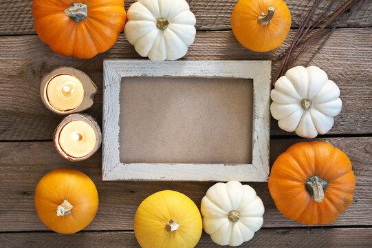Mini pumpkins around wood frame