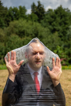a man is stuck in a plastic bag - a prisoner of plastic