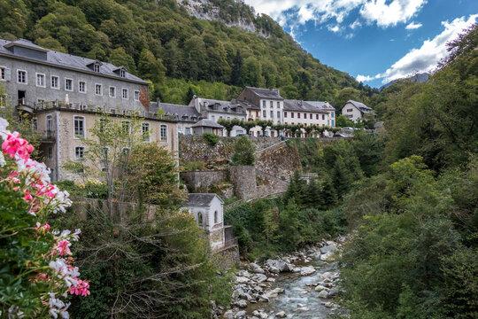 River and Eaux-Bonnes picturesque village close to the small town of Laruns, Pyrenees National Park, France