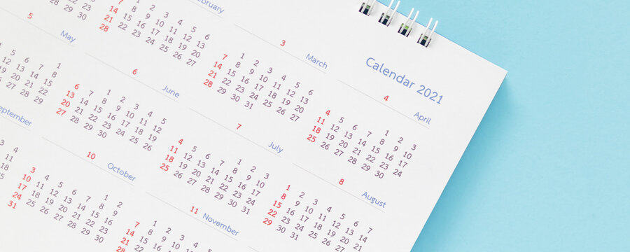 2021 calendar page on blue background business planning appointment meeting concept