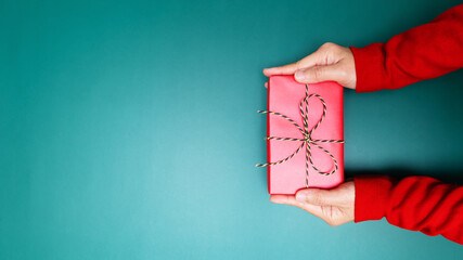 Happy Boxing Day, young woman hand with a gift box offer to rece