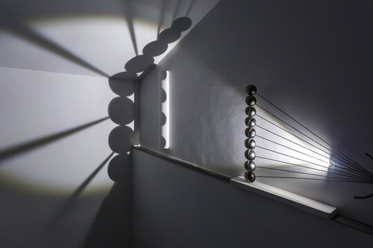 abstract design of balls on metal rods