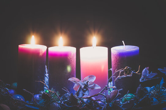advent decoration with three burning candles