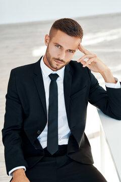 Thoughtful businessman portrait in modern creative office