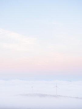 Windmills peeking out of the fog as seen from Mount Wachusett on an autumn morning in Massachusetts.