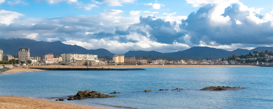 Saint-Jean-de-Luz in France, panorama of the bay and the pier, beautiful light